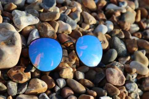 black farmed sunglasses on rocks